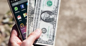 mobile phone money banknotes us dollars 163069 - Why are mobile phones a huge part of gaming?