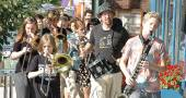 """The Friends Music Camp Street Band marched a quick downtown loop Saturday afternoon to announce their concert that evening, """"Musicians for Justice and Peace,"""" which benefited Glen Helen. (Photo by Matt Minde)"""