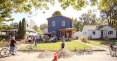 PorchFest, a musical round-robin affair, had villagers and visitors walking to porches, driveways and backyards to hear a wide array of local musicians perform. (Photo by Matthew Collins)