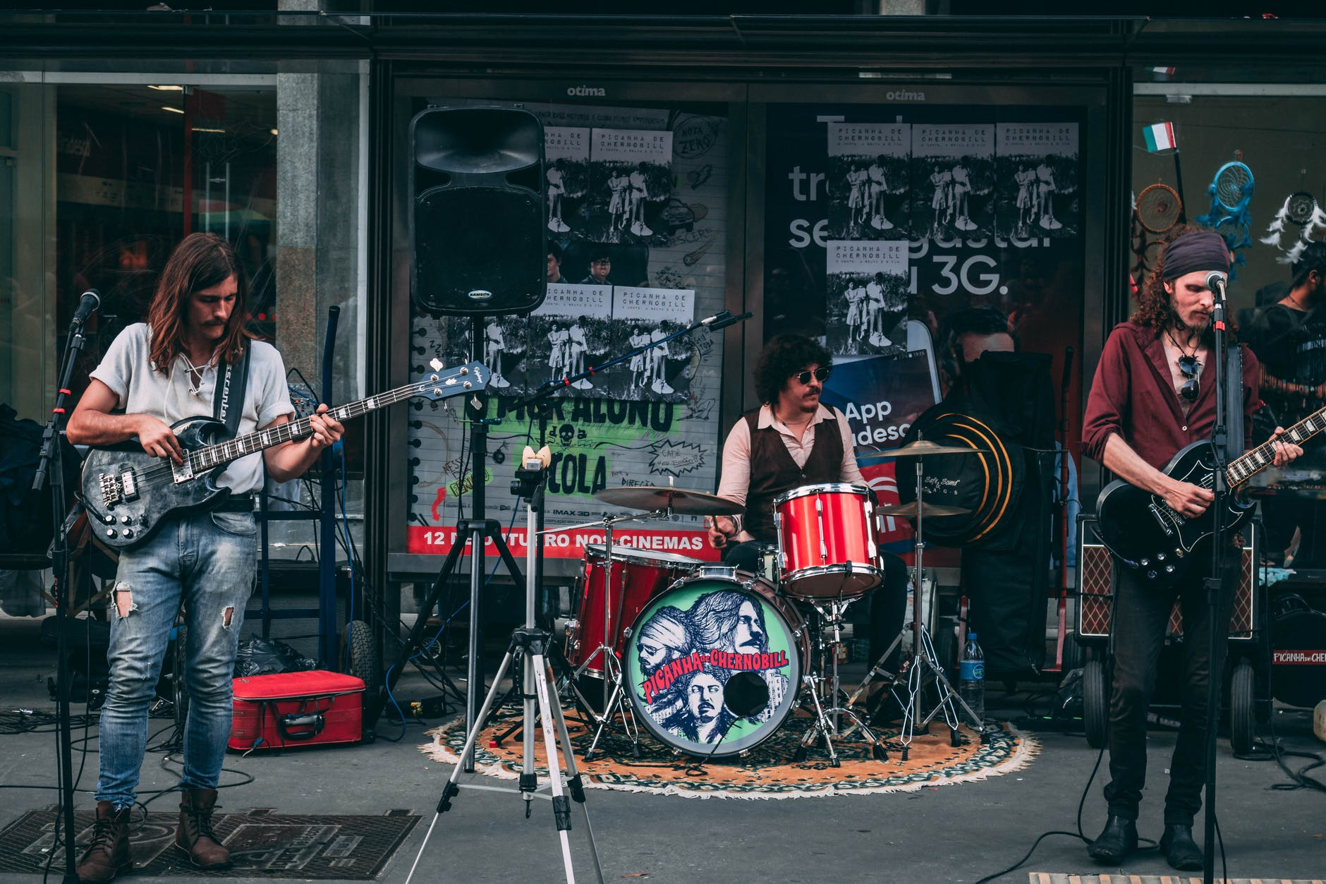 music band performing in front of building