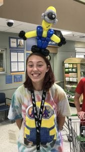 Minion Balloon figure on a hat at publix thanks to boars head event Tampa florida