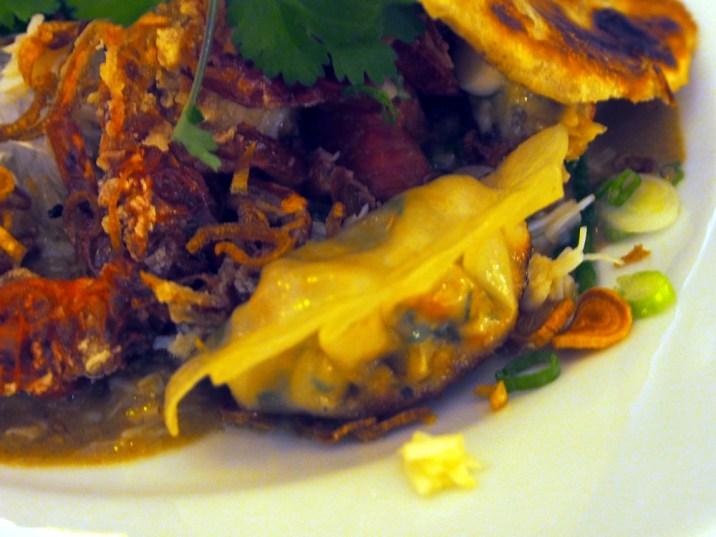 crab gyoza, smoked brown crab, tamarind & coconut laksa, harusame noodles | Yvanne Teo