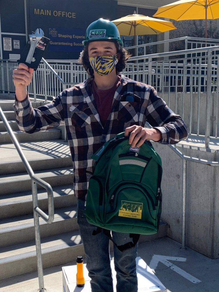 Nevada Union High School Senior, Ryan Crabtree holds a supply bag that includes tools, first aid kit, and personal protective equipment.