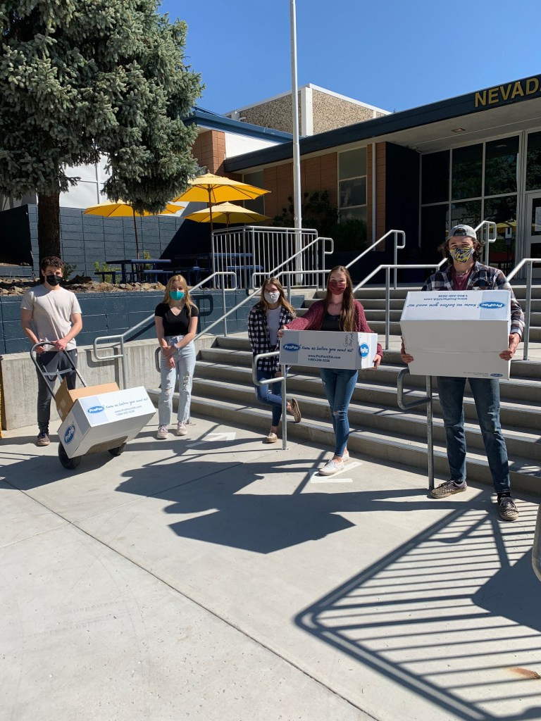 Marcel Armstrong, Emmalee Oistad, Taylor Demaranville, Marin Martin, Ryan Crabtree, help move CERT supplies to the classroom where training will be conducted.