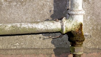 Rusted and leaking household water pipe