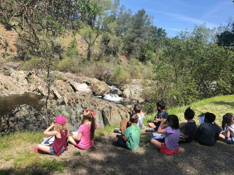 Kindergarten teacher Corrine Garcia pilots Yuba River watershed currirculum during a nature walk with Lone Tree Elementary students.