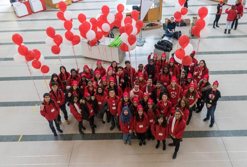 York Ambassadors standing in a heart shape with balloons