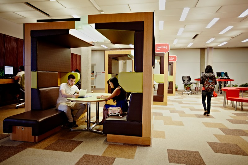 An image of two students sitting in a Learning Skills Services study booth.