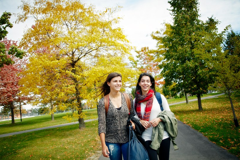 A photo of two girls walking on a path at York University.