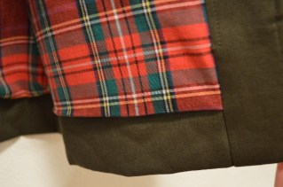 Bottom hem from the inside of the jacket, covered by the lining.