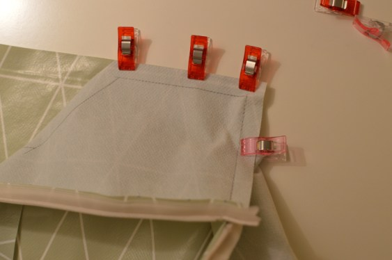 """Clip"" and sew one stretch at a time (red clips). The pink clip to the right just keeps the oil cloth in place."