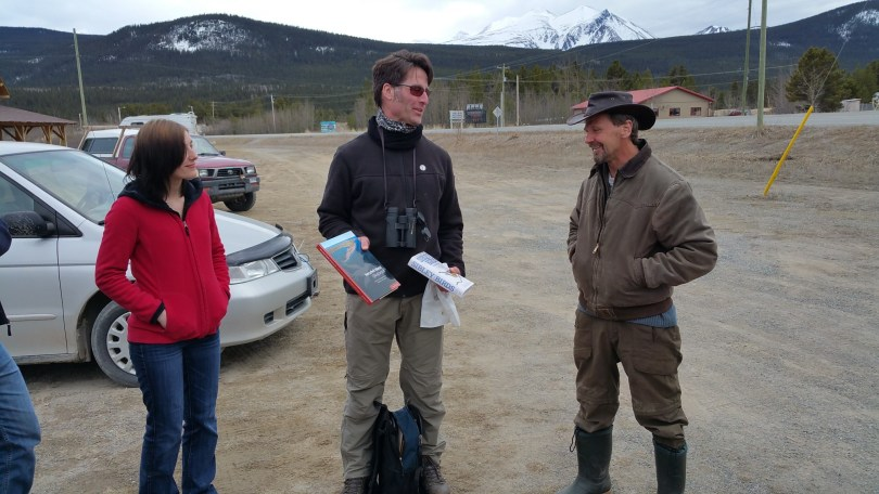 Jim Hawkings photo. Under the watchful eye of director Shyloh van Delft, YBC president Cameron Eckert presents Carcross birder Dan Kemble with several books as part of the 2015 Raven Award. The presentation was made in Carcross prior to Dan's annual Dusky Grouse field trip on 24 April 2015.