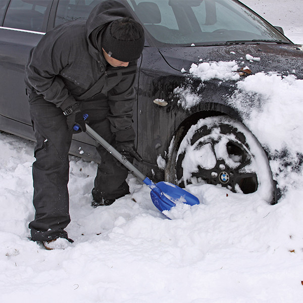 Sport Utility Shovel-Digging Snow Away from Tire