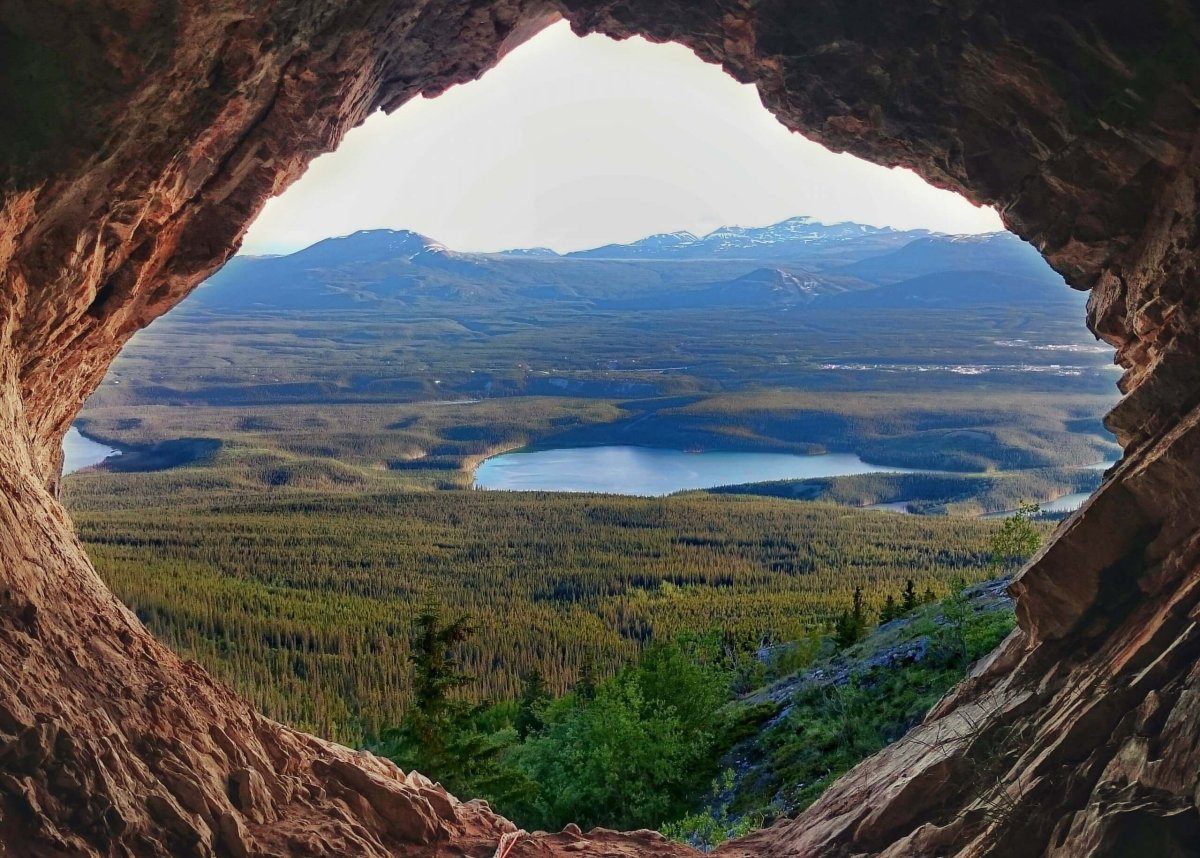 The view from the Grey Mountain cave which overlooks the mountains, lakes, and forest below