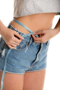 close-up-of-girl-measuring-her-waist_1163-659