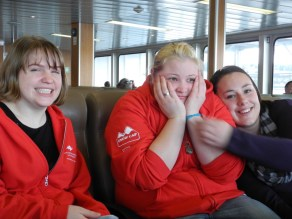 Taina, Josie and Leah sit at the front of the ferry.