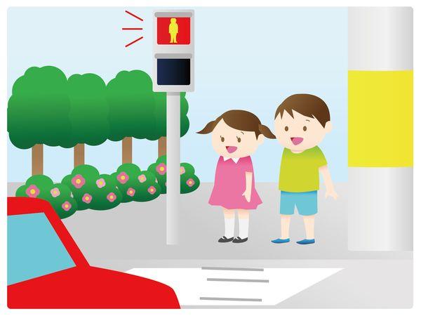 横断歩道の手前で立ち止まる
