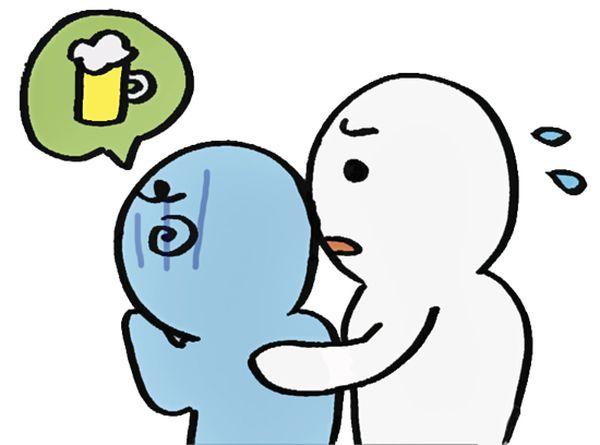 酔っ払った人を介抱している