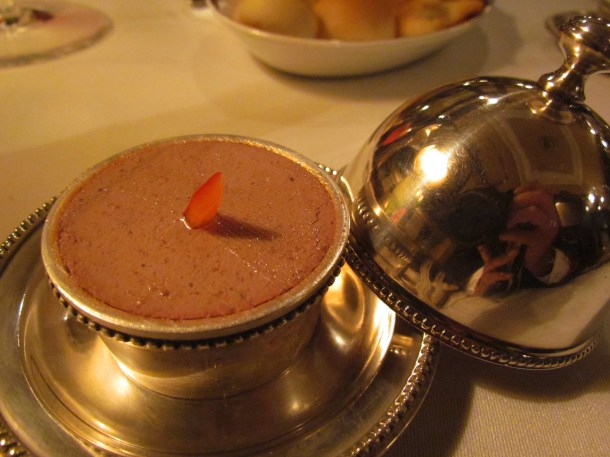 chicken liver pate served in a tiny lid-container