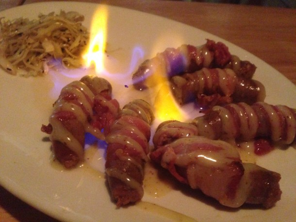 pig in a blanket with whiskey flavor, served with live flame.
