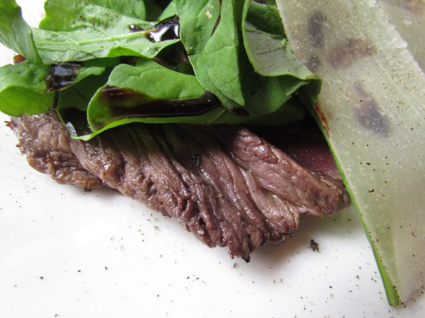 Tagliata sliced grilled tenderloin served with rocket and Parmesan'