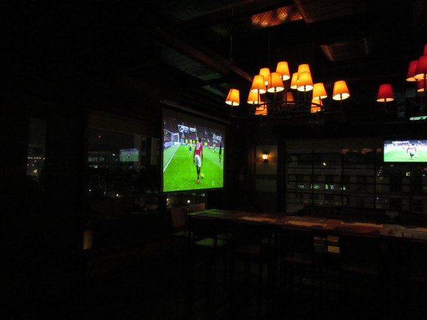 Large screen in indoor dining area