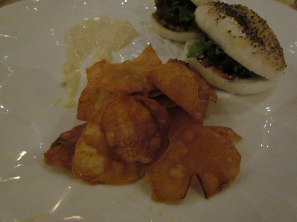 Sweet potato chips served with Tian rice bun burger tenderloin
