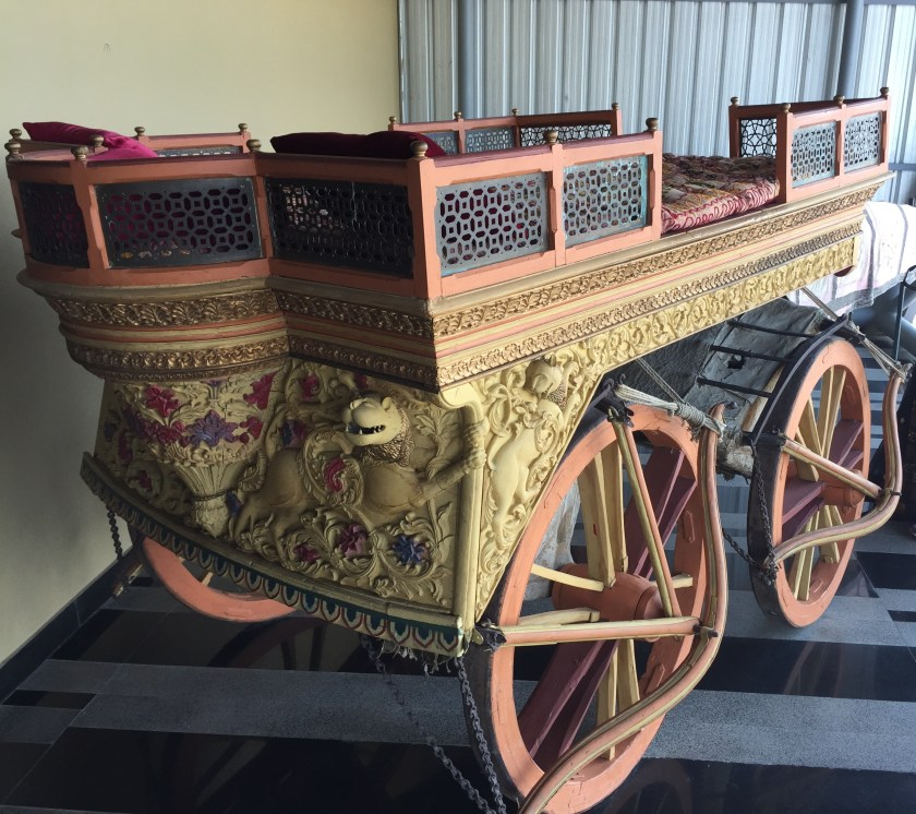 a beautiful carved , animal drawn carriage