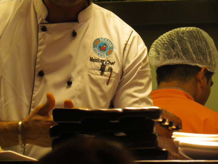 'Mexican Chef' reads the embroidery on Chef's chest. I over heard him screaming at his boys in thet Hariyanvi!!!! :):)