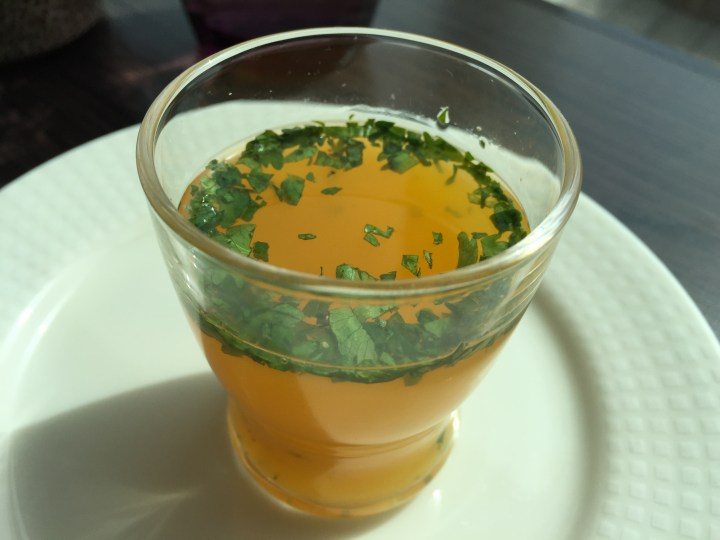 Orange and pineapple drink with herbs