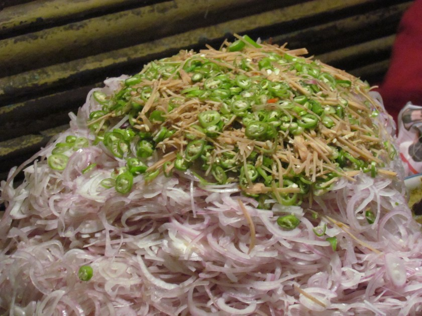pile of onion, ginger  and chillies