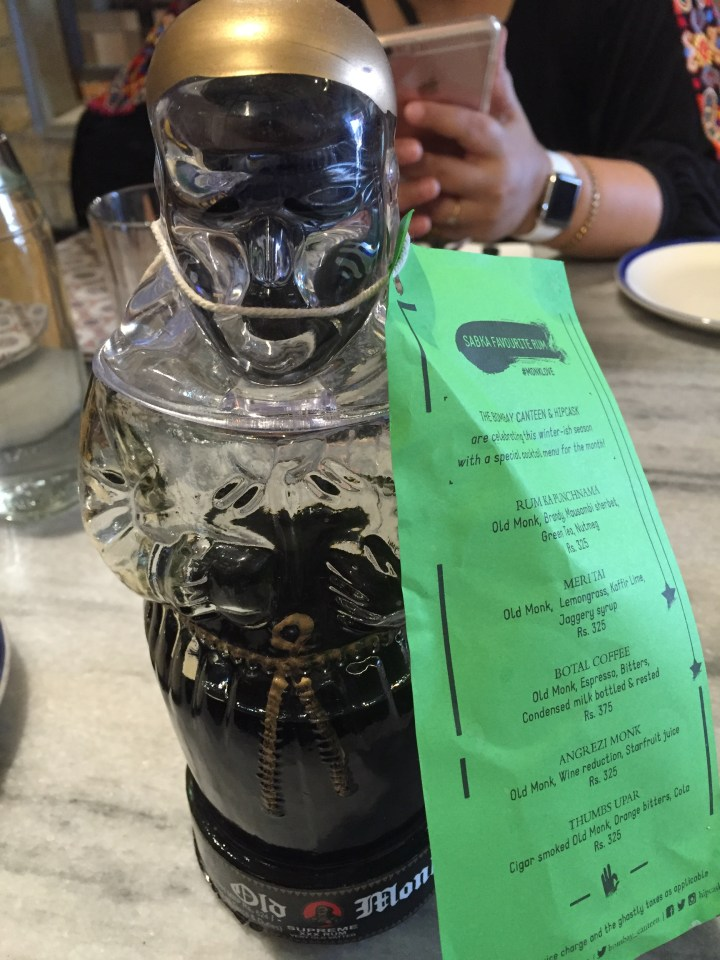 old monk bottle with a list of old monk based cocktails