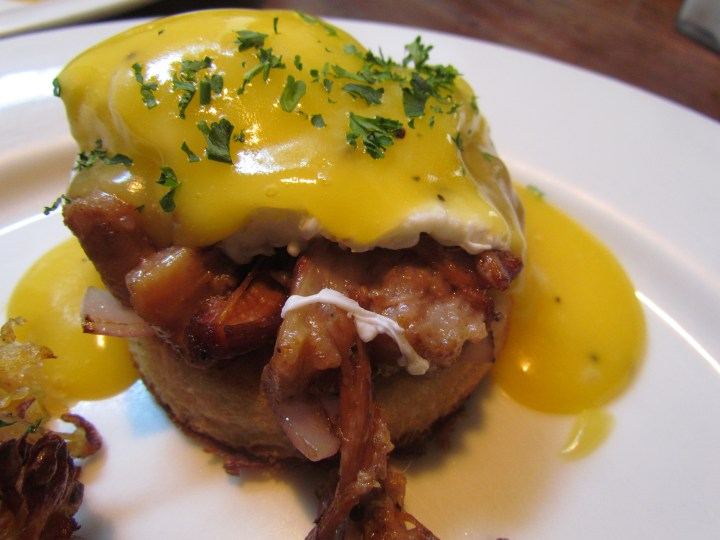 Eggs benny with slow cooked pork belly, caramel onions and bearnaise sauce