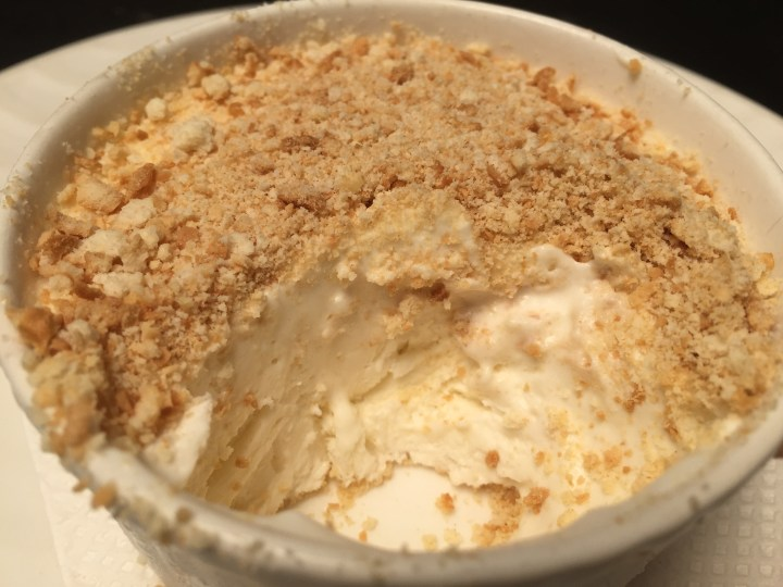Serra dura - traditional Goa Portuguese dessert from condensed milk and whipped cream, topped with cookie crumble