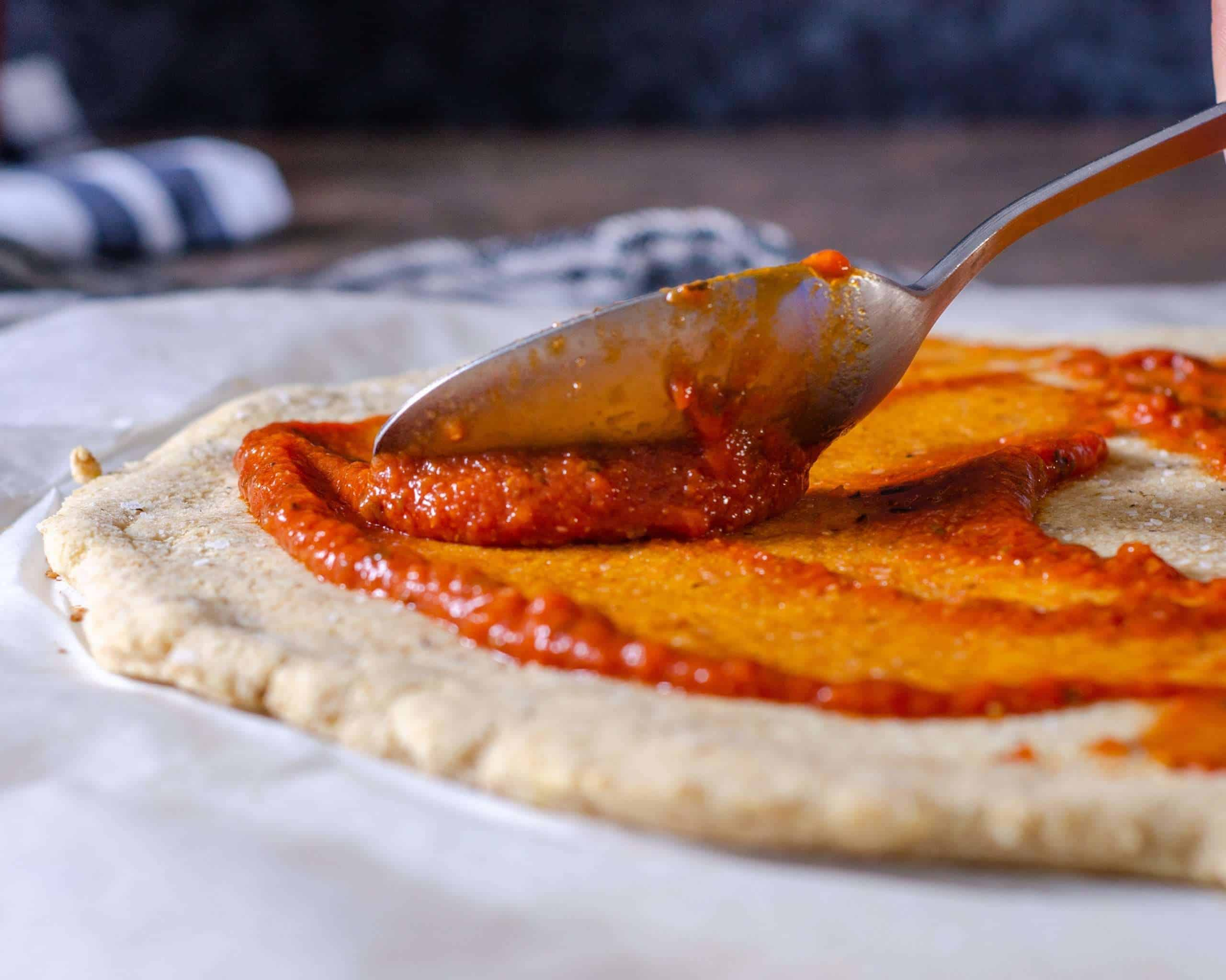 Keot pizza sauce spreading on low carb pizza dough