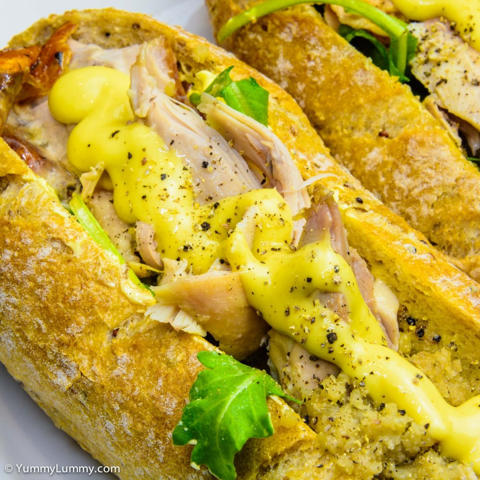 Wholemeal and quinoa pane di casa with lashings of butter and a layer of roquette topped with roast chicken and stuffing and a line of mustard, my delicious chicken roll