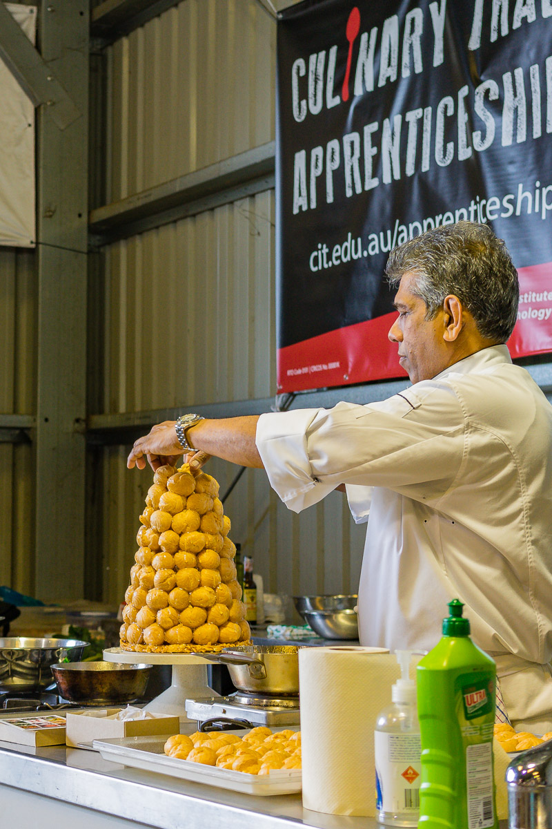 This is a photograph of the Capital Regional Farmers Market cooking demonstration. Croquembouche.