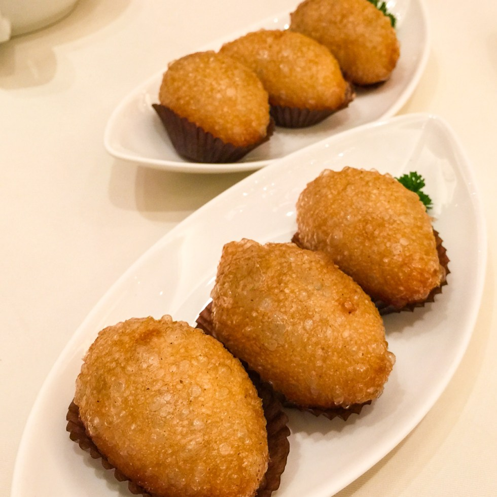A photograph of Deep fried dumplings with sticky rice and pork