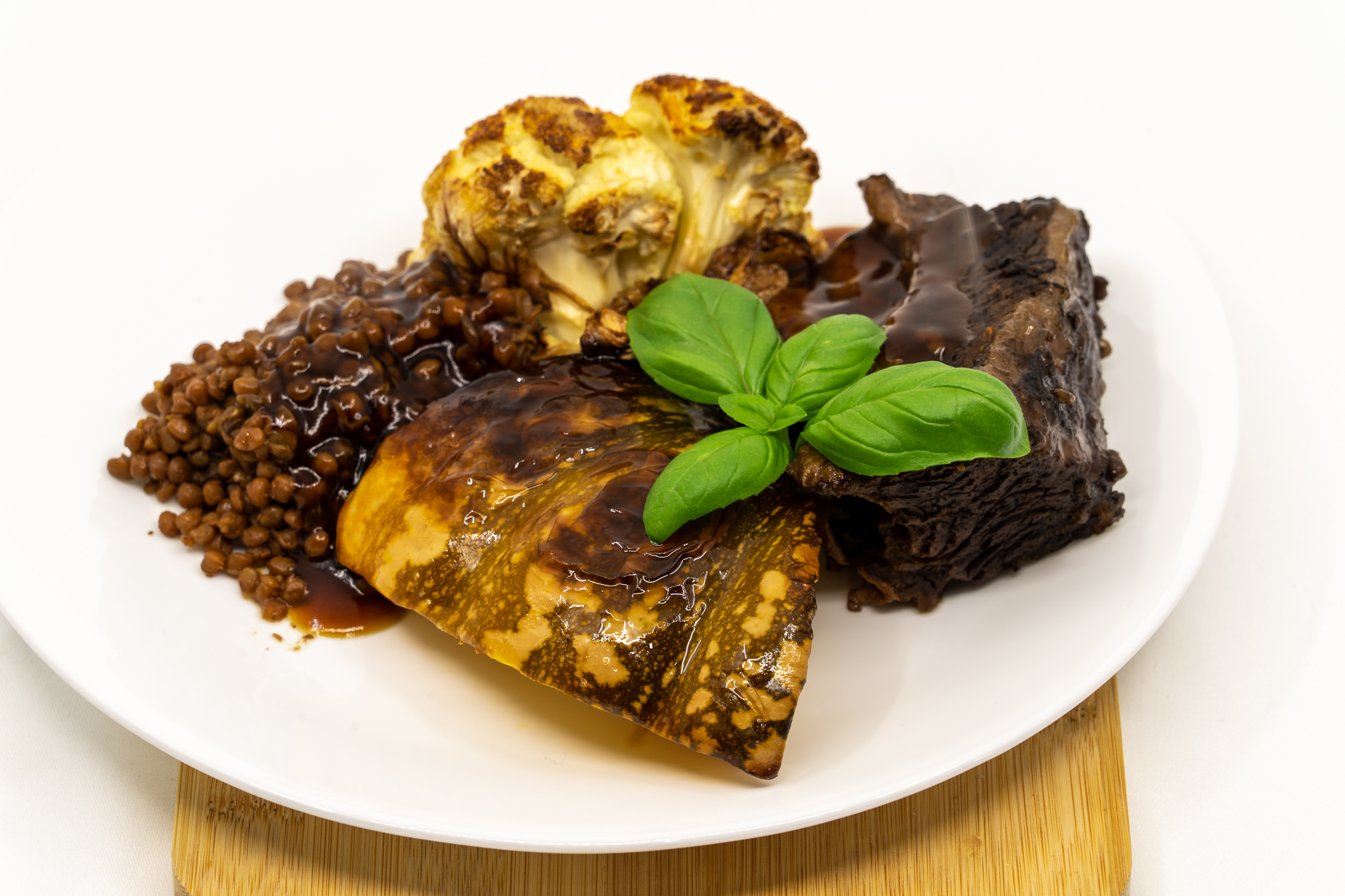 Beef short rib fingers and lentils with roast Tabasco flavoured pumpkin and cauliflower, smothered with gravy