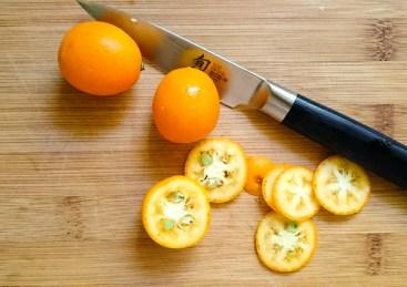 Thinly slice the kumquats