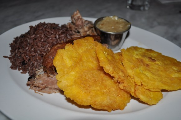 Lechon Asado with Tostones and Moro Rice
