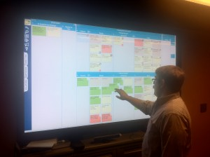 Bandit Software CEO, Chris Hefley, using LeanKit Kanban on an 82-inch touchscreen