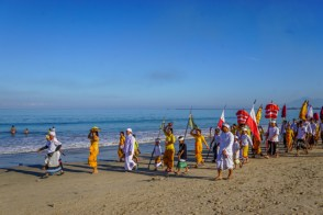 We meet a procession on the beach