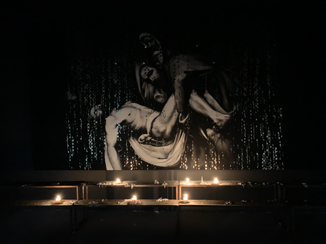 This installation is very impressive as the room is illuminated by the candles only