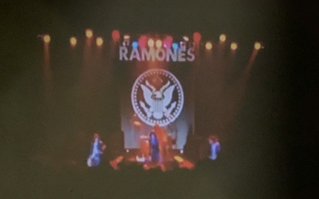 We're watching a concert of the Ramones on our terrace