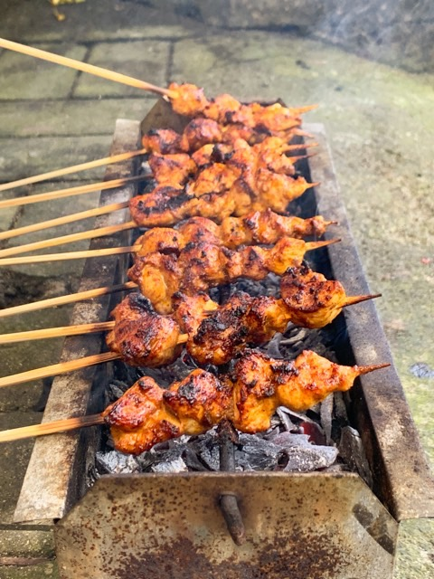 The chicken skewers look delicious while they sizzle on our small sate grill