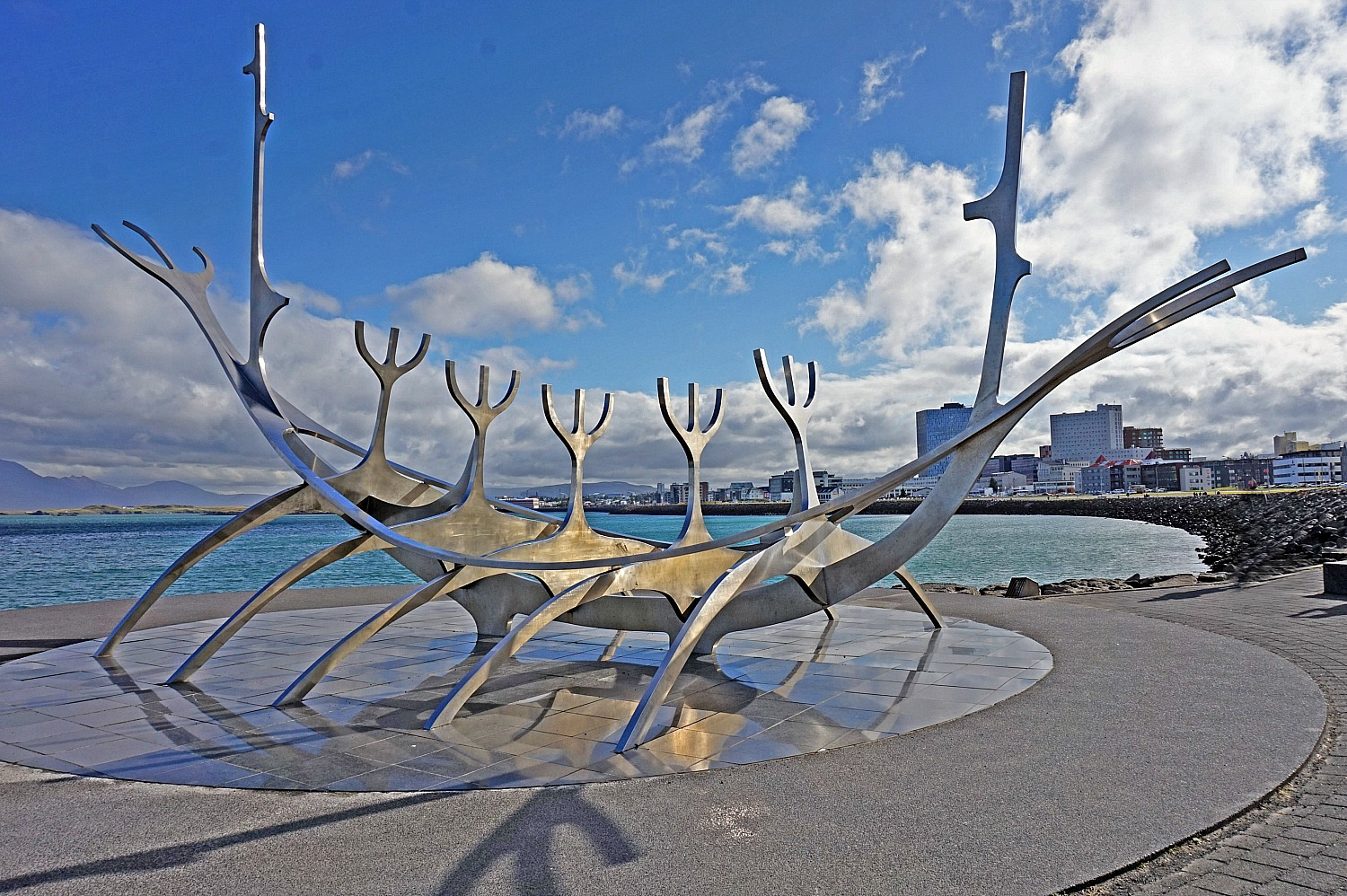 10 top reasons to visit Iceland. The Sun Voyager sculpture located in Reykjavik symbolizes a dreamboat – an ode to the sun, discovery, progress, and freedom.