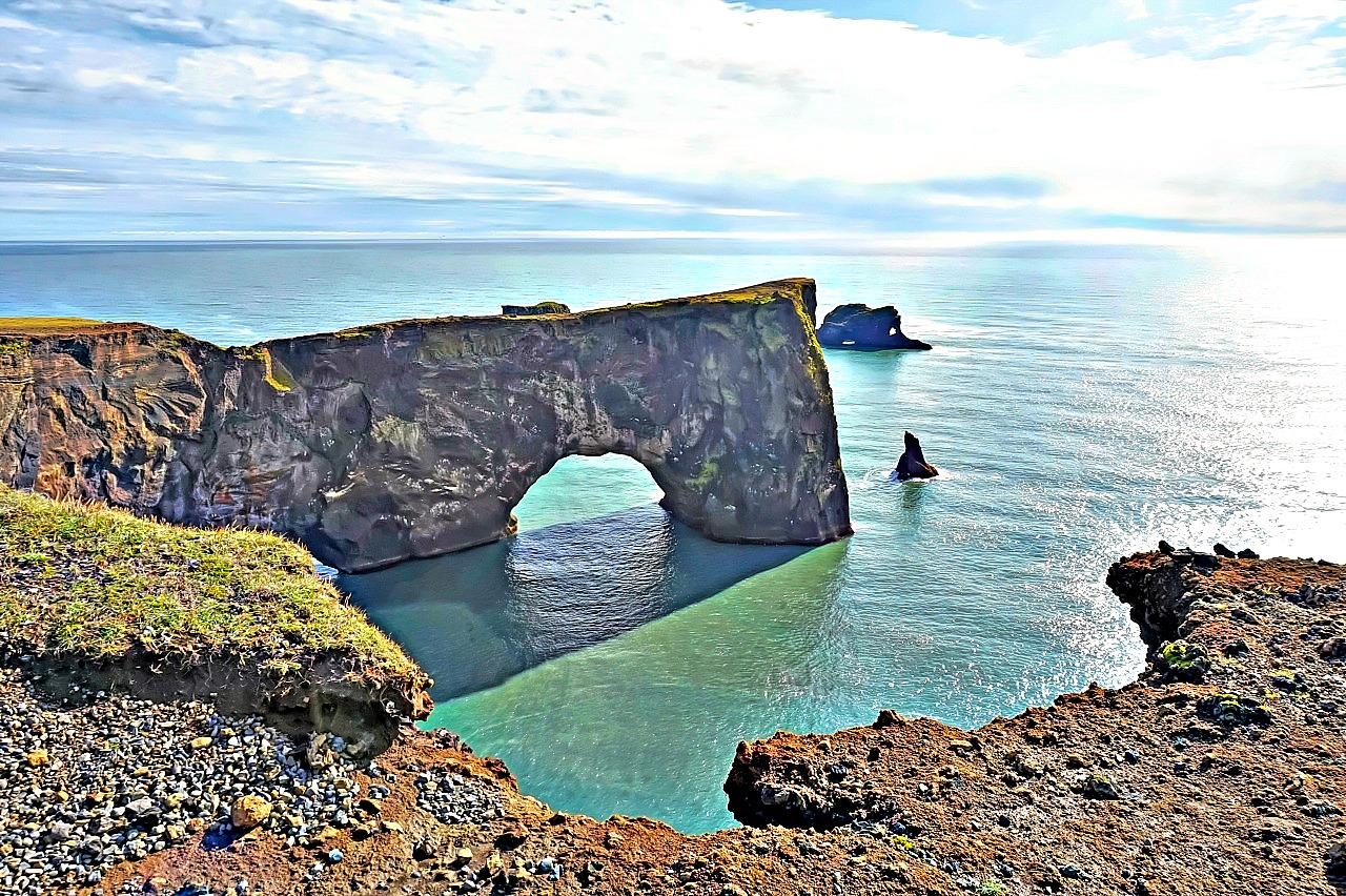 10 top reasons to visit Iceland. Dyrholaey Arch in Southern Iceland adds to the diversity of the area around Vik.