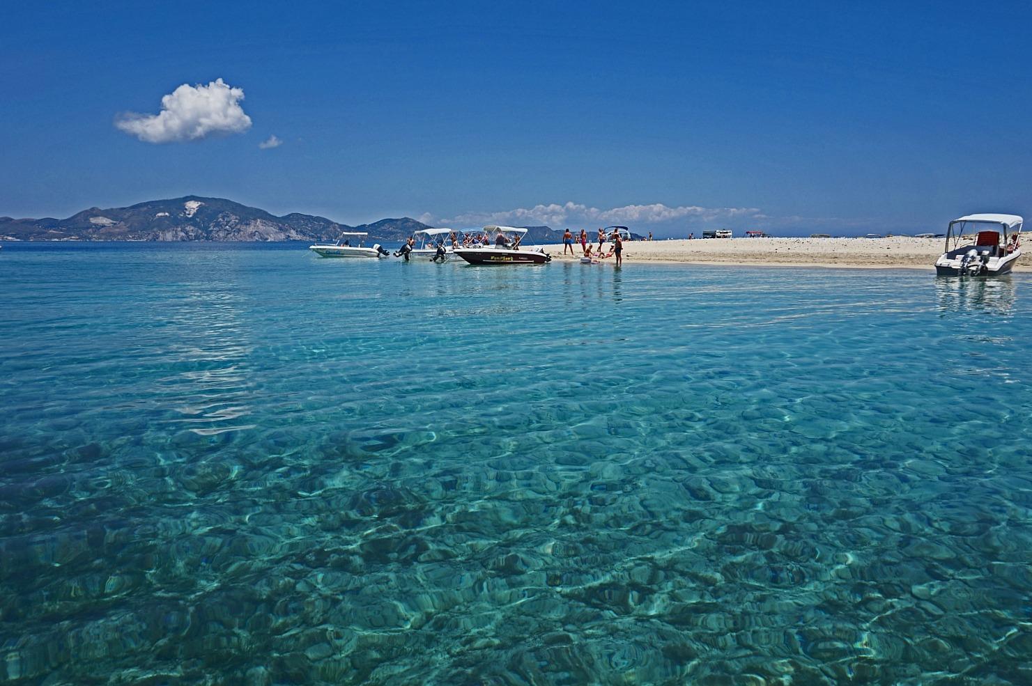 Zakynthos Greece - how to visit. Clear blue water and the boats.