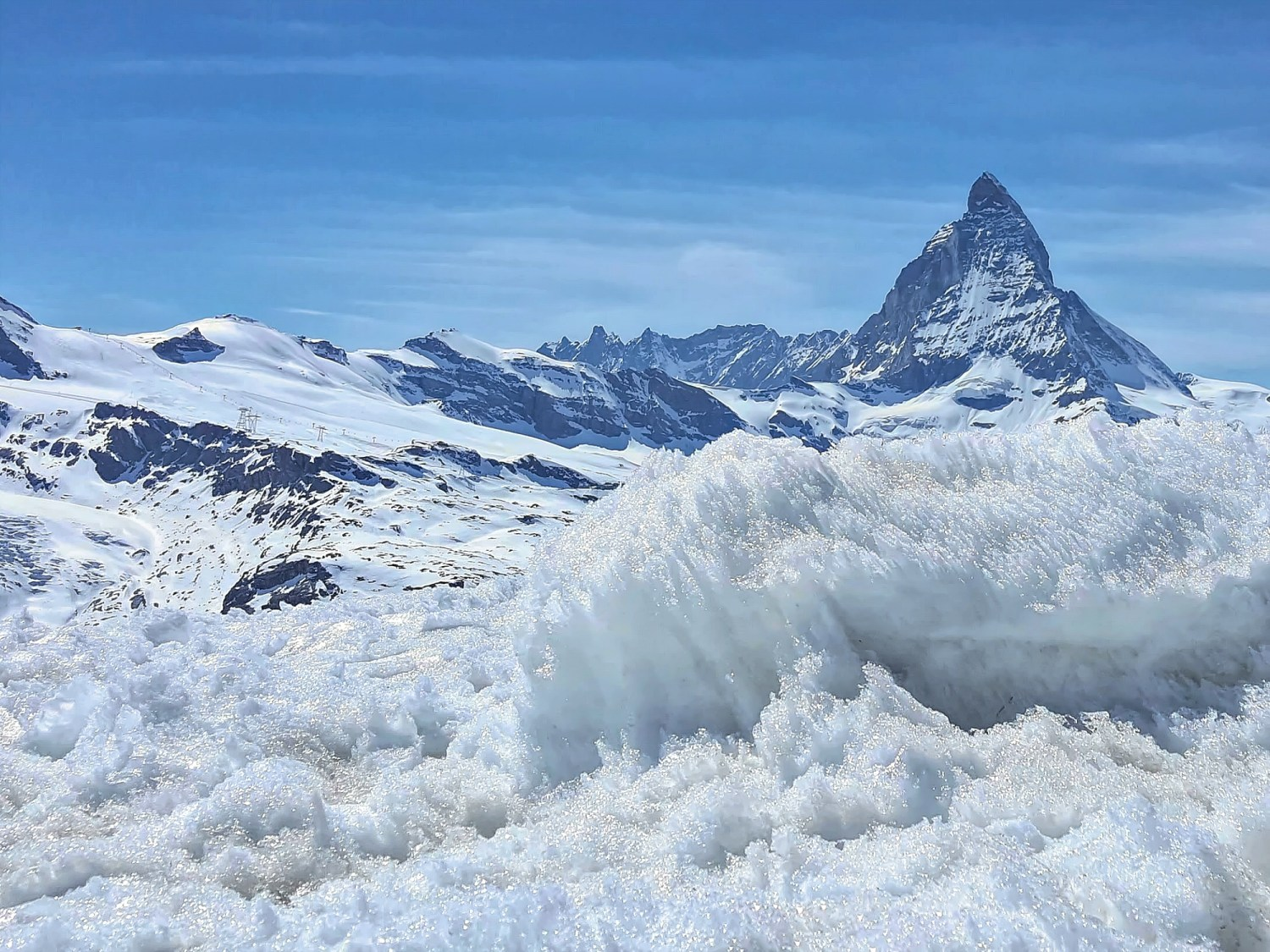 View of Matterhorn Zermatt from behind a bank of snow.